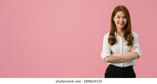 Portrait of young Asia lady with positive expression, arms crossed, smile broadly, dressed in casual clothing and looking at camera over pink background. Panoramic banner background with copy space.