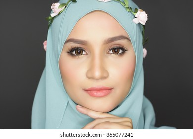 portrait of young asian beautiful muslimah woman posing for a camera