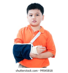 Portrait of a young Asian boy with broken arm in plaster cast, isolated on white background.