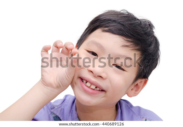Portrait of young asian boy losing his tooth