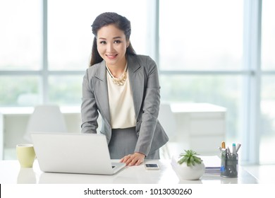 Portrait of young Asian business lady working in office
