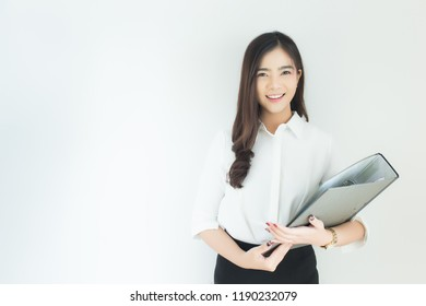 Portrait of young asian business woman hold dossier over white background.