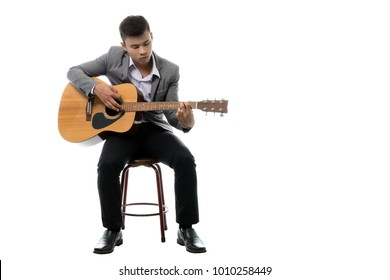 Portrait of a young asian businessman with guitar. Isolated on white background