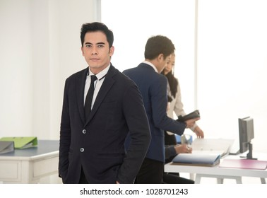 Portrait young asian businessman handsome looking for something.