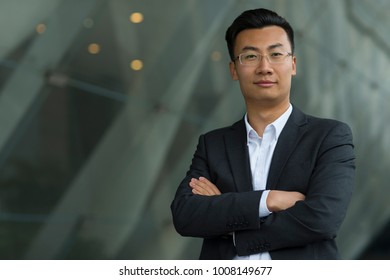 portrait of young asian businessman looking at camera smile