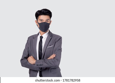 Portrait young asian businessman in suit confident crossed his arms wear face mask for protective covid-19 isolated on white background, business man quarantine for pandemic coronavirus, new normal.