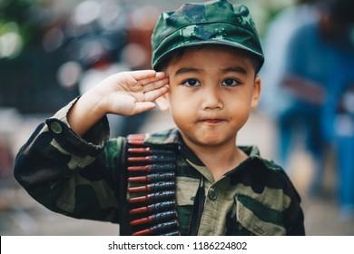 Portrait of young Asian children in Soldier uniform