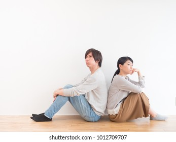 portrait of young asian couple in living room