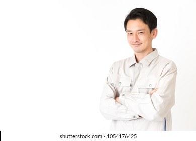 portrait of young asian engineer worker isolated on white background