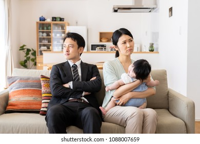 portrait of young asian family in living room