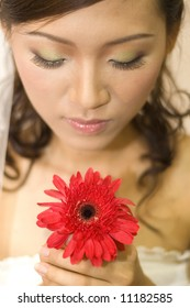 portrait of young asian girl holding a flower