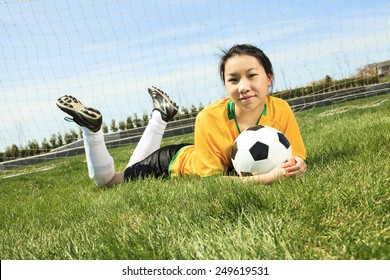 Portrait of young Asian girl with soccer ball