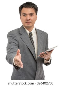 portrait of young asian handsome businessman handshake & holding tablet pc, isolated on white