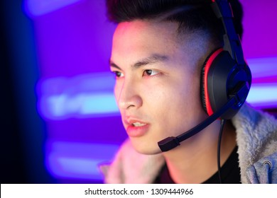 Portrait of Young Asian Handsome Pro Gamer Playing in Online Video Game