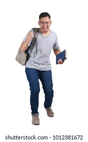 Portrait of young Asian male student standing isolated on white, winning success gesture