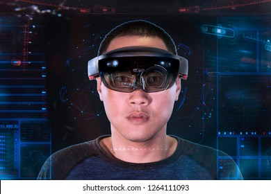 Portrait of young asian man with 3D virtual reality glasses microsoft hololens | VR panel like Iron Man