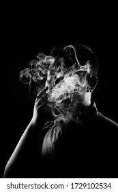 portrait of young asian man. illustration of a young person smoking a dark concept. concept of photos about humans and cigarettes
