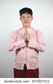 Portrait of young Asian man Mon in Thailand in beautiful costume dress on white background.  Concept of ethnicity, culture and way of life.