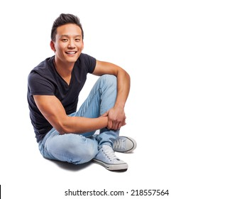 portrait of a young asian man sitting on the floor