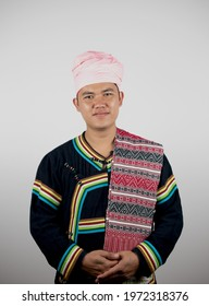 Portrait of young Asian man Tai Lue in Thailand in beautiful costume dress on white background.  Concept of ethnicity, culture and way of life.