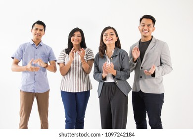 portrait of young asian people clapping their hand together