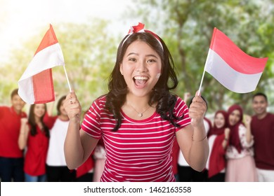 portrait of young asian people taking selfie during indonesia independence day celebration