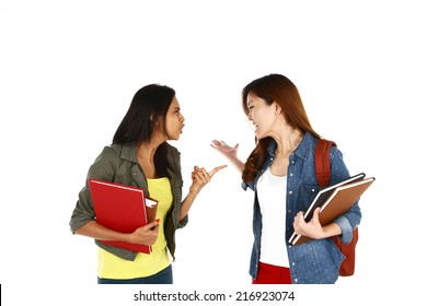 Portrait of young Asian students in an argument, isolated on white background