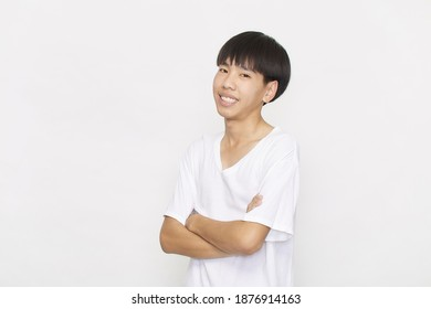 Portrait Young Asian Teenager student male wearing a white shirt with arms folded on white background