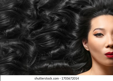 Portrait of young Asian woman with beautiful curly hair