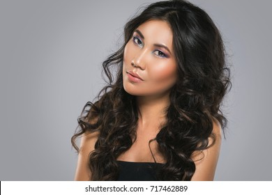 Portrait of Young asian woman with a beautiful curly hair