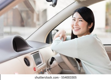 portrait of young asian woman in car