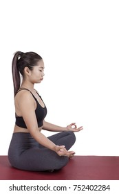 Portrait of young asian woman exercise playing yoga isolated white background
