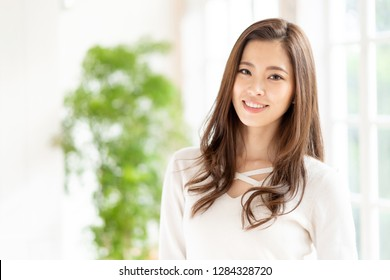 portrait of young asian woman hair care image