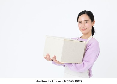portrait of young asian woman holding box isolated on white background