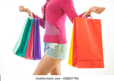 Portrait of young asian woman holding shopping bags isolated on white background