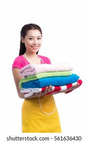 A portrait of a young asian woman holding clothes