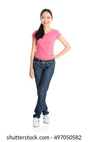 Portrait of young Asian woman in pink shirt and jeans with ponytail hair is smiling, full length standing isolated on white background.