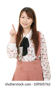 Portrait of young asian woman pointing