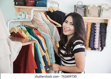 portrait of Young asian woman shopping in a fashion store
