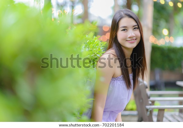 Portrait of young asian woman with smiling pretty.
