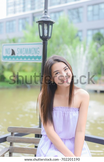 Portrait of young asian woman with smiling pretty