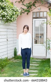 portrait of young asian woman standing in garden