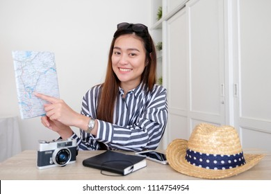 Portrait of young asian woman travel blogger holding map while recording video, live streaming, on social media,  blogger and vlogger concept