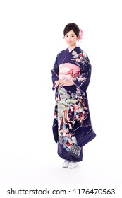 portrait of young asian woman wearing purple kimono on white background