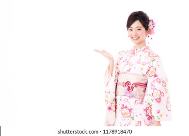 portrait of young asian woman wearing pink kimono on white background