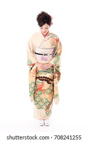 portrait of young asian woman wearing furisode isolated on white background