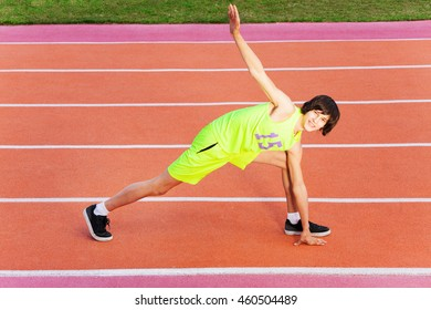 Portrait of young athlete exercising outdoor