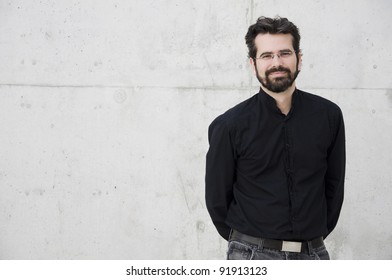 Portrait of young attractive adult against a wall
