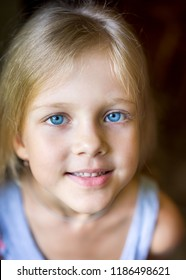 Portrait of young attractive beautiful blonde girl with blue eyes with a smiling and positive expression of the face