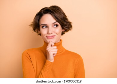 Portrait of young attractive beautiful thoughtful happy girl thinking look copyspace isolated on beige color background